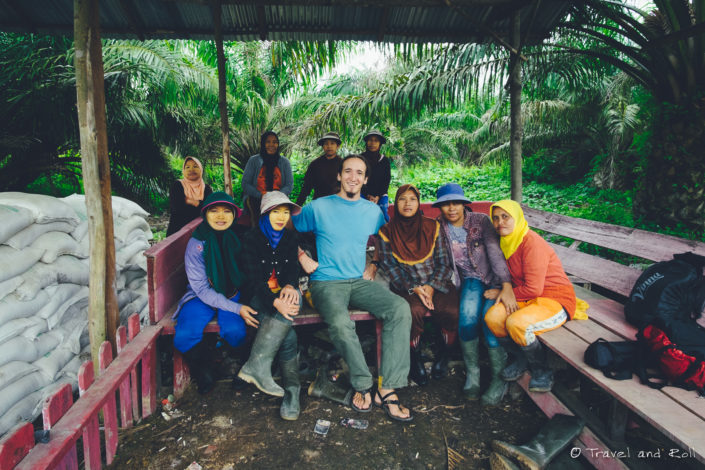 In a field of palm trees with the workers while on a documentary about deforestation in Indonesia