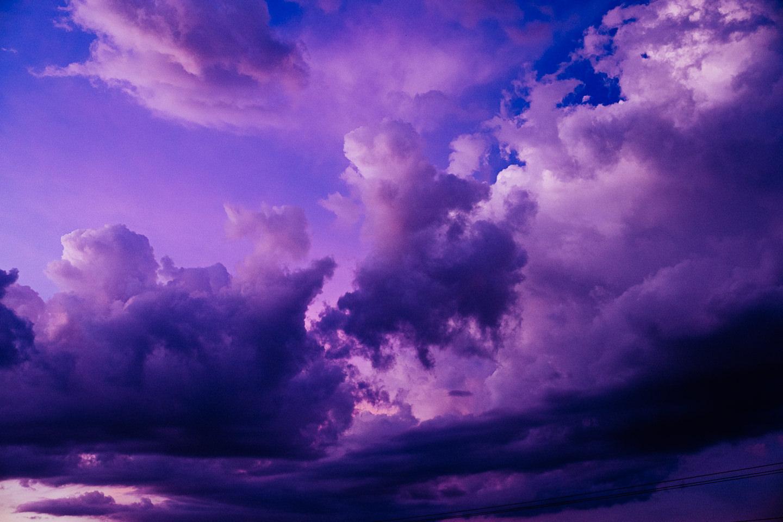Purple sky with dark clouds